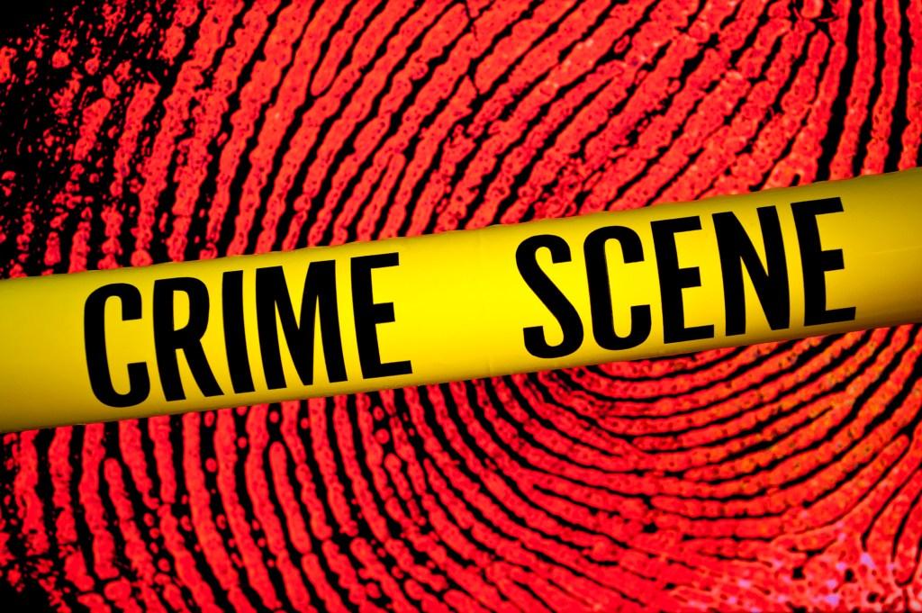 Crime scene tape in front of fingerprint