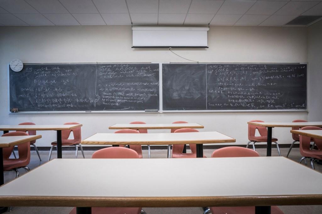 Equations on blackboard in empty classroom