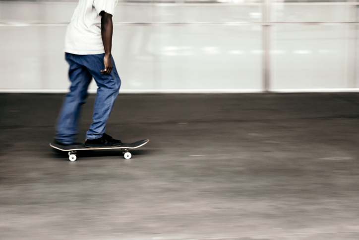 Low Section Of Man Skateboarding In Park