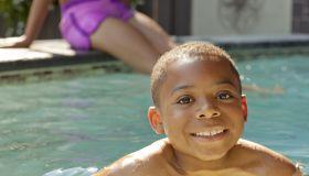 African American boy swimming in swimming pool