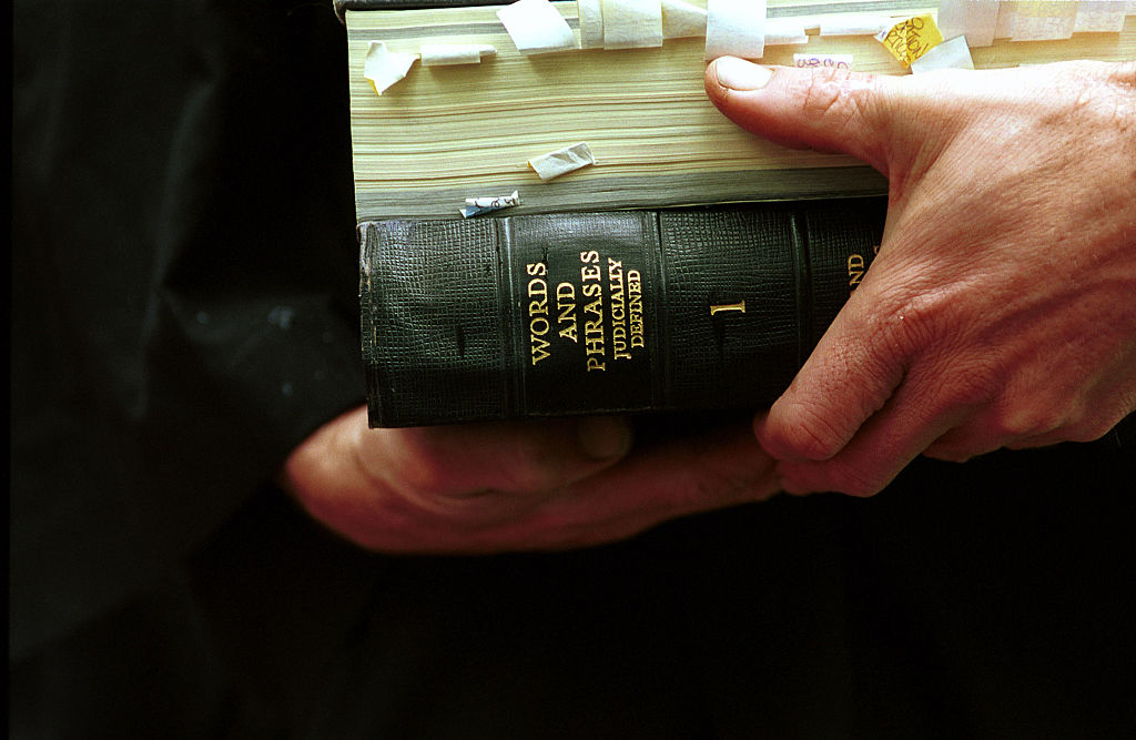 A man hold several law volumes with markers, 26 March 2002. AFR Picture by ERI