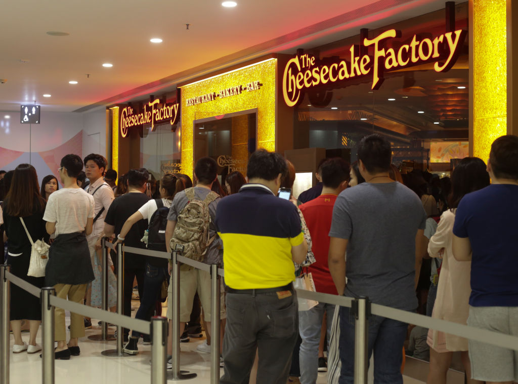 People queue up for the The Cheesecake Factory in Harbour City, Tsim Sha Tsui. 01MAY17. Photo: May Tse. [02MAY17 FEATURES FOOD ONLINE]