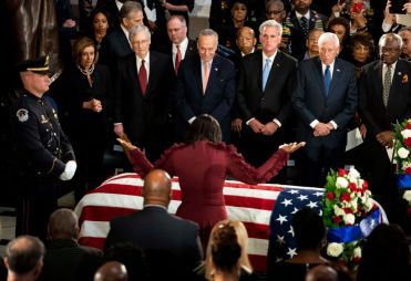 WASHINGTON, DC - OCTOBER 24: Maya Rockeymoore Cummings prays ov