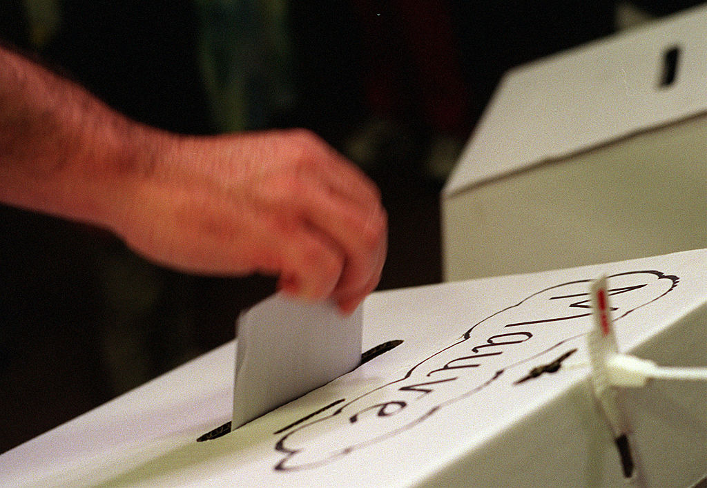 A voter casts their ballot at Williamstown Primary School in Melbourne, during t
