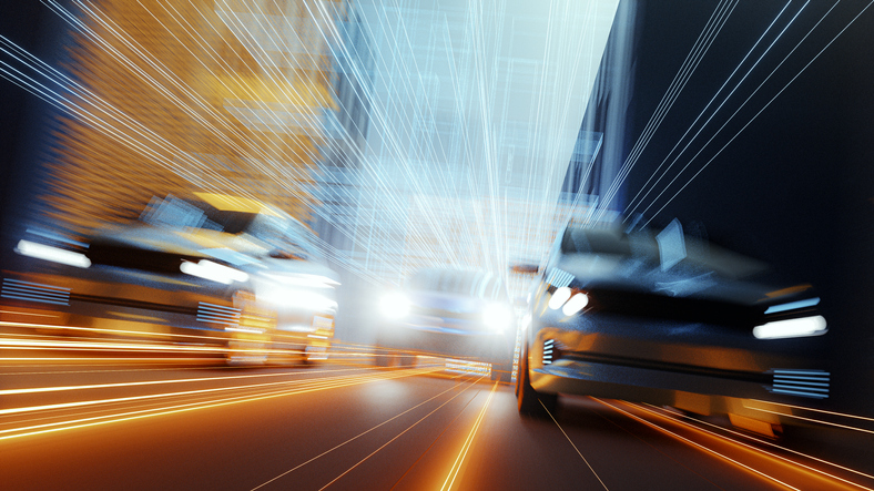 Generic speeding cars in futuristic city