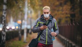 Young man with protective face mask on her way to training
