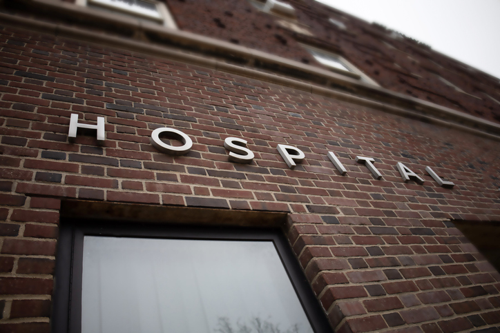 generic hospital sign on brick building facade