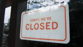 Closed sign on a store window