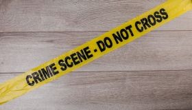 Crime scene tape on wooden background