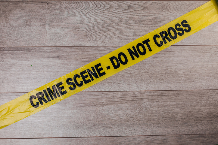 Crime scene tape on wooden background