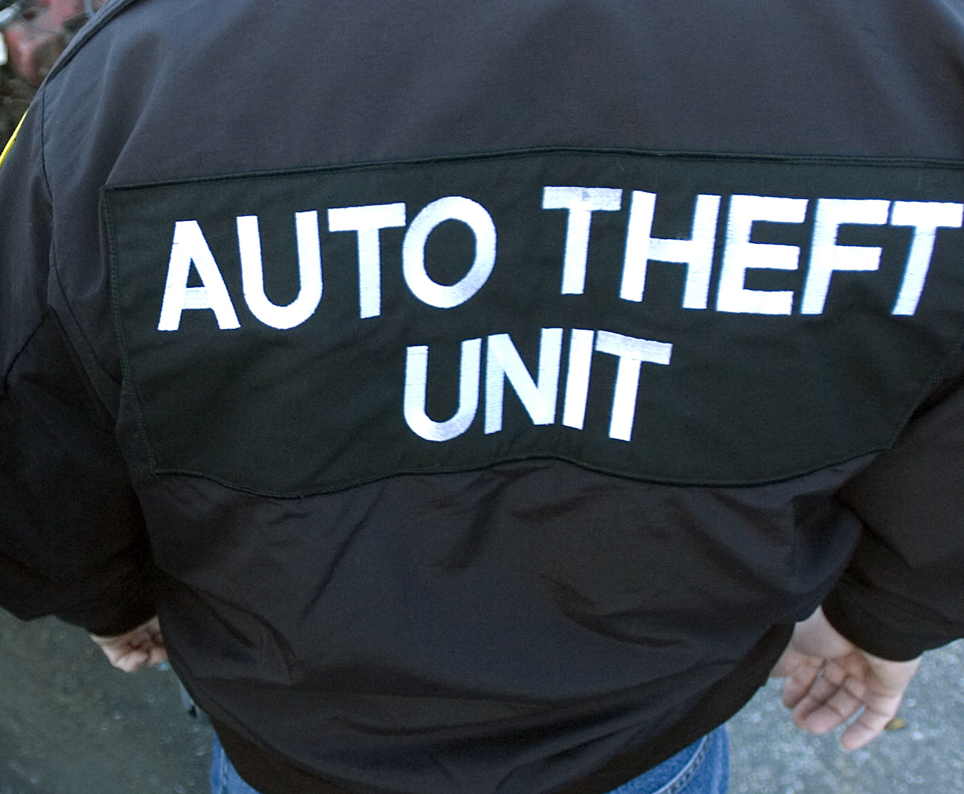 12/12/2007 Reading, PA 200702683Two Reading Police Officers with the Central Pennsylvania unit of the State Police Auto theft task force Wed afternoon next to a car at Vince's towing that had was stolen and stripped.Reading Eagle Photo