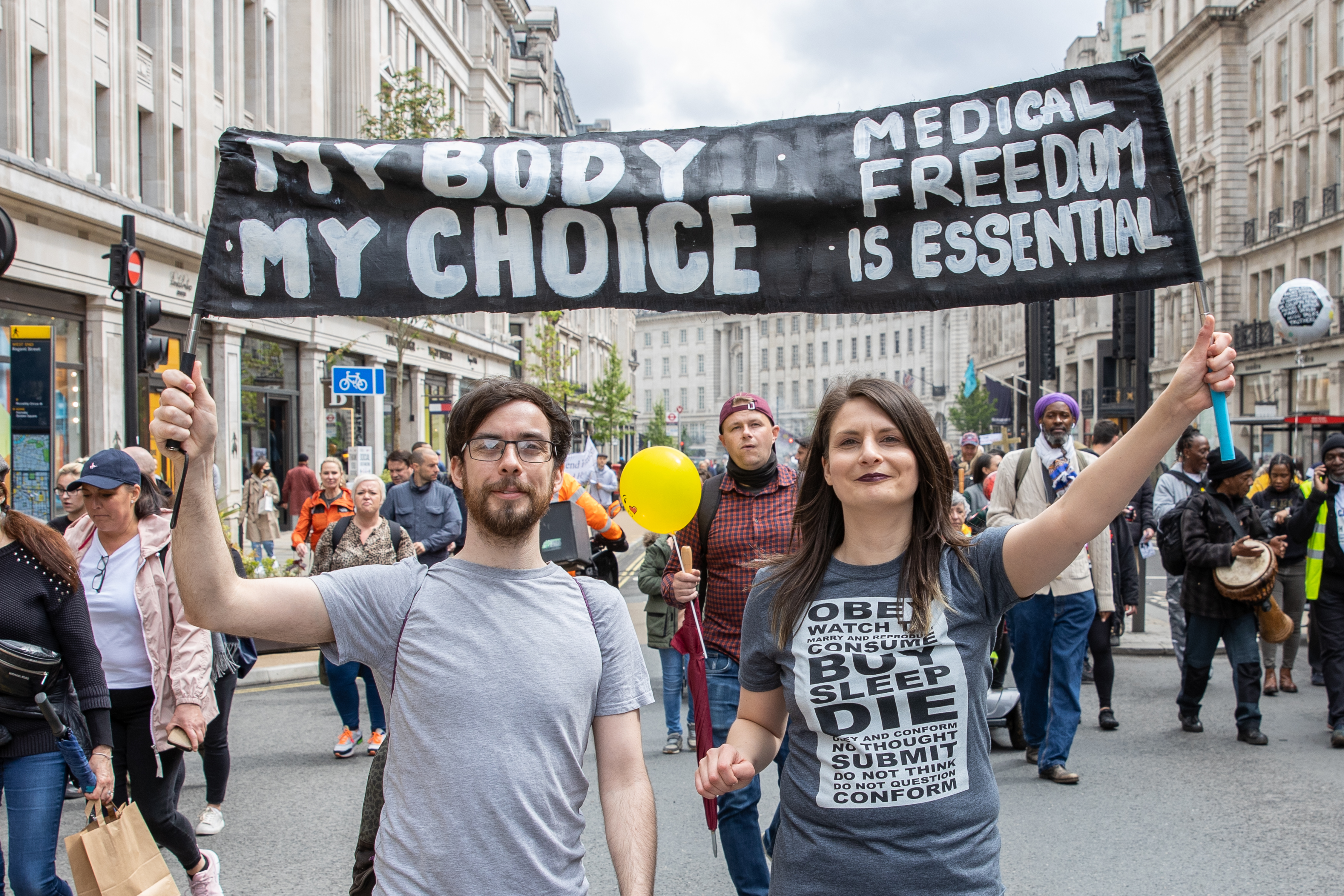 Anti lockdown and anti vaccine protestors march through London