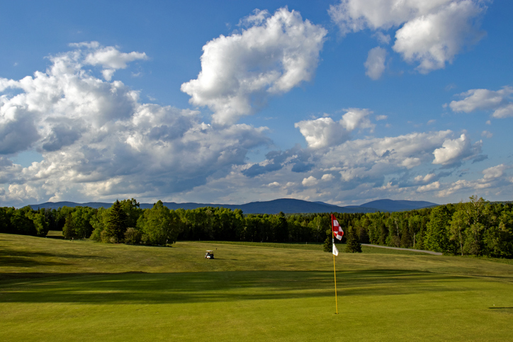 Mingo Springs Golf Course near Rangeley, Maine with golf cart in background