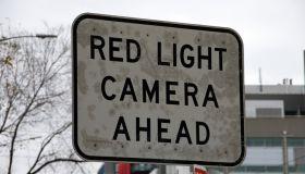 'Red light camera' traffic warning sign