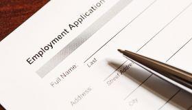 Job application form and pen